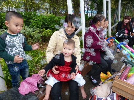 Amber and Trissie playing with bubbles while waiting for the rain to stop.