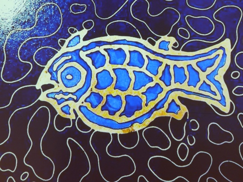 Images of fish and other oceanic creatures were scattered about the beautiful blue and gold enamel floor.