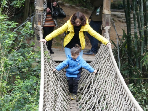 Amber and Trissie crossing the hanging bridge at Evergreen Resort.