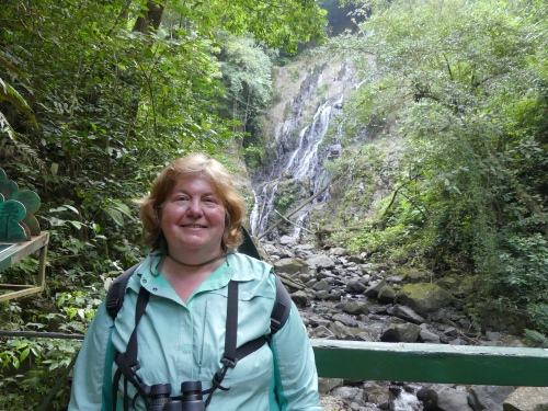Diane in front of the beautiful waterfall at Canopy Adventure.